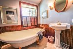 The guest bathroom features a classic clawfoot bathtub.