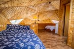 The third bedroom, located in the loft above the living area, has a full and twin bed.