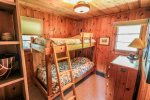 The second bedroom features twin bunk beds.