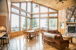 The spacious, open living area features floor to ceiling windows that overlook Lake Superior.