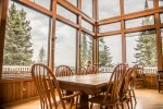 The solid wood dining room table has seating for up to 10 guests so everyone can dine with great views of Lake Superior.