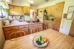 The large eat-in kitchen has everything you need to prepare a home cooked meal during your stay.
