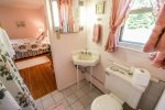 The attached bathroom to the master bedroom has a walk-in shower.