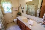 The guest bathroom has a shower/tub combo.