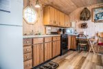 Thoughtful touches and careful crafting make you feel right at home in the cabin`s kitchen.