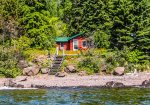 While not directly on the Lake, Croftville Road is a quiet road with little traffic and that`s all that separates the cabin from the shoreline.