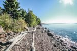 Enjoy the unique cobblestone beach at the Opels Lakeside Cabins during you stay.