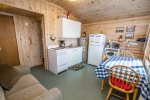 The cabin features a small kitchen, eating, and living area.