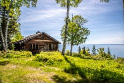 Black Point is a classic Minnesota vacation log cabin that will transport you back in time to the early days on the North Shore of Lake Superior.