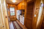 The full sized fridge and stove make this kitchen ample size for cooking.