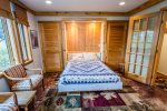 The murphy bed folds down for a queen sized bed.