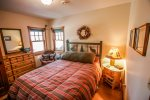 The lower level bedroom features a queen bed and lots of privacy.