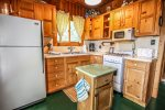 Kitchen  equipped with full size appliances and gas stove