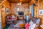 Cozy living area with t.v. and woodstove