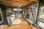 Second level provides the perfect space for that afternoon nap in front of this wood stove.