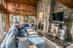 Cozy up after hiking in front of this beautiful stone fireplace and flatscreen TV.