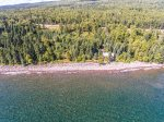 Enjoy a peaceful surrounding with a large section of private Lake Superior shoreline and lots of trees.  You have just one close neighbor cannot see the home unless on a certain part of the beach.