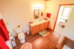 The master bathroom is attached to the master bedroom and features a shower and jetted tub.