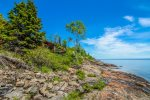 Foxfire is situated just feet from a private ledge rock beach on Lake Superior.