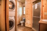 The bathroom has a walk-in shower and washer/dryer.