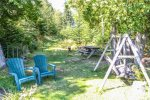 Enjoy the lawn furniture and picnic table along the edge of Caribou Lake.