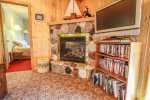 Curl up in front of the gas fireplace and watch a movie on the flat screen TV.