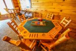 Play a hand of Poker or Go Fish around the card table.