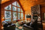 The floor to ceiling windows in the spacious living room provide amazing Lake Superior views. NOTE: Fireplace is currently not operational.