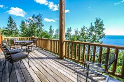 Aspenwood 6526 is a cheerful 3 bedroom family vacation townhome in Tofte with panoramic views of Lake Superior.