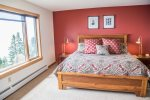 The second guest bedroom is located in the upper level and features a nice queen bed.
