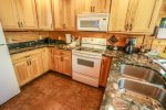 The beautiful kitchen features granite counter tops and full size appliances.