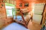 The third bedroom has a twin over double bunk bed and a laundry area, great for extended stays.