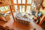 Phoenix Cabin has a beautifully appointed, open concept living area with floor to ceiling windows.