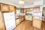 The large kitchen is well-equipped and includes a dishwasher.
