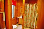 The attached bathroom has a walk-in shower.