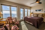 The master bedroom has a queen sized bed, sitting area, desk, mini bar, and spectacular Lake Superior views that you can enjoy from every corner of the room.