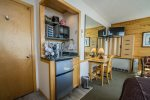 This unit does not have a kitchen, but has a mini bar/kitchenette great for late night snacks and drinks.