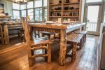 Unique reclaimed wood dining room table provides seating for everyone to enjoy a home cooked meal.