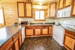 You are in the Gunflint Trail wilderness, but this home offers modern amenities like a dishwasher in the kitchen.