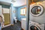 The guest bathroom on the main level has a walk-in shower and washer/dryer- great for extended stays.