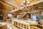 Enjoy the open ceiling with wood beams and a cat walk going above the dining room area.