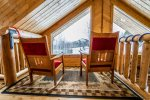 Sit back in this reading nook and enjoy amazing views of the Sawtooth Mountains.