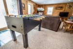 Enjoy a game of Foosball in the lower level living room.