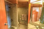 Each of the 3 bathrooms in this home features a tiled walk-in shower.