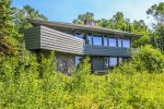 This home has 3 bedrooms, 3 bathrooms, and a beautiful private section of Lake Superior shoreline.