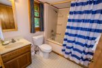 The larger bedroom, located on the east side of the home near the master bedroom, has a shower/tub combo.