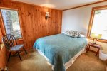 The master bedroom features a queen sized bed.