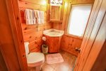 The one bathroom in this cabin has a walk-in shower.