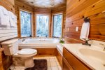 The main guest bathroom has a jetted tub with peek-a-boo Lake Superior views.