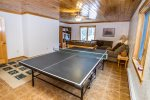 The game room in the bunk house has a ping pong and foosball table.